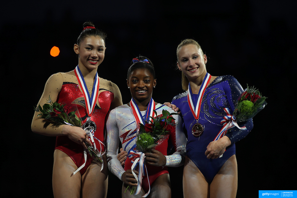 Simone Biles, Spring, Texas, (centre), on the podium with Kyla Ross, Aliso Viejo, California, (left) and Brenna Dowell, Odessa, Missouri, after winning the All-Round title during the Senior Women Competition at The 2013 P&G Gymnastics Championships, USA Gymnastics' National Championships at the XL, Centre, Hartford, Connecticut, USA. 17th August 2013. Photo Tim Clayton