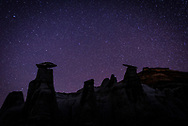 A picture of the night sky with some hoodoo formations. Taken in the Bisti Badlands wilderness.<br />