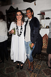 Left to right, LAURA MERCIER and RUBY HAMMER at a party to celebrate the launch of Laura Mercier's perfume Ambre Pssion Elixir held at Momo's, 25-27 Heddon Street, London on 27th May 2010.