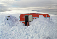 Trailer partly buried in snow