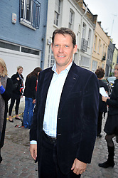 FRANK ARNESEN sporting director of English football club Chelsea F.C at a private view of paintings by Johnny Madsen at Mews 42 Gallery, 42 Princes Gate Mews,  South Kensington, London on 15th April 2009.