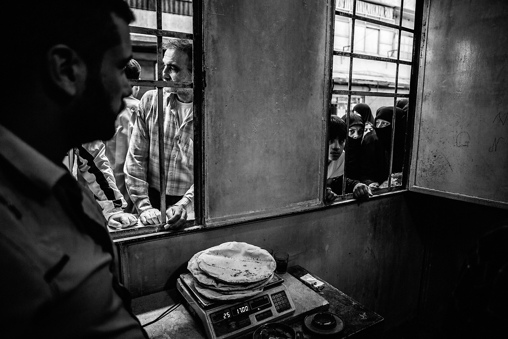 Aleppo, Syria, 2012/10/04.<br /> Sha'ar district.<br /> Everyday, despite the danger of mortar hits, Syrian people go to buy bread at the bakery.