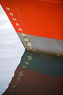 Hand painted depth markers on the bow of a boat in the harbor at Cape Town, South Africa.