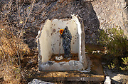 A makeshift shrine with statues of the Virgin Mary and the Christ child was erected at Mendoza Canyon, Coyote Mountains Wilderness Area, Sonoran Desert, Arizona, USA,