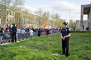Baltimore, Maryland - April 21, 2015: A police officer stands guard on the lawn of the Baltimore Police Department's Western District during a vigil-turned-protest march for Freddie Gray. Hundreds of protestors came out Tuesday night. Freddie Gray was injured while detained by police, and died from his injuries Sunday. His spinal cord was 80% severed.<br /> <br /> CREDIT: Matt Roth for The New York Times<br /> Assignment ID: 30173645A