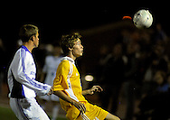 9 NOV. 2010 -- ST. LOUIS -- Christian Brothers College High School soccer player Tim Michel (14, right) battles St. Louis University High School's Tommy Behr (20) for control of the ball during the MSHSAA Class 3 Sectional game at SLUH Tuesday, Nov. 9, 2010. The Jr. Bills won, 2-1, on a pair of first half goals by Ryan Merrifield. SLUH will take on Jackson High School Saturday, Nov. 13 at Jackson. Image © copyright 2010 Sid Hastings.