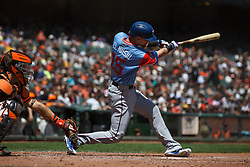 SAN FRANCISCO, CA - AUGUST 26: Carlos Tocci #15 of the Texas Rangers at bat against the San Francisco Giants during the third inning at AT&T Park on August 26, 2018 in San Francisco, California. The San Francisco Giants defeated the Texas Rangers 3-1. All players across MLB will wear nicknames on their backs as well as colorful, non-traditional uniforms featuring alternate designs inspired by youth-league uniforms during Players Weekend. (Photo by Jason O. Watson/Getty Images) *** Local Caption *** Carlos Tocci
