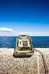 Adding machine on retaining wall, Salton Sea Beach, California