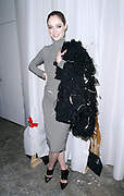 Coco Rocha poses backstage at Christian Siriano during the Mercedes-Benz Fall/Winter 2015 shows at Artbeam in New York City, New York on February 14, 2015.