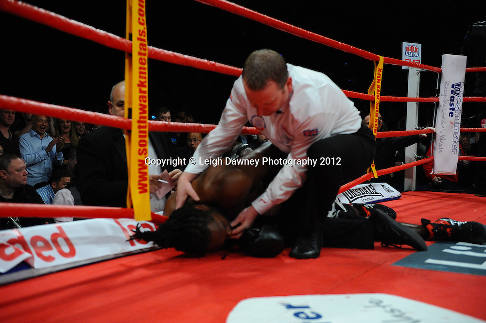Referee attends to Audley Harrison after being knocked down by David Price at The British & CommonwealthTitle fight at the Echo Arena, Liverpool on 13th October 2012. Frank Maloney Promotions © Leigh Dawney Photography 2012.