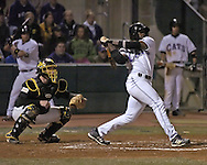 Kansas State's Byron Wiley drives the ball to the outfield against Wichita State.  K-State defeated the 19th ranked Shockers 6-3 at Tointon Stadium in Manhattan, Kansas, March 14, 2006.