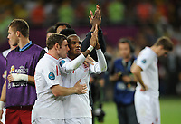 Football - European Championships - England vs. Italy<br /> England's James Milner comforts Ashley Young as their team go out following his missed penalty at the Olympic Stadium, Kiev, Ukraine