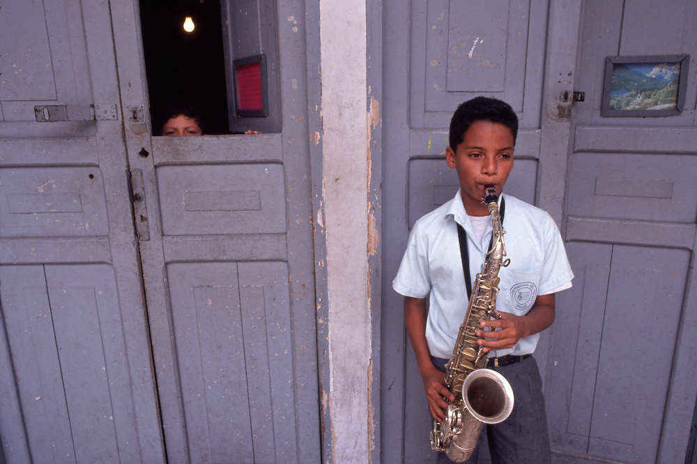 Young Saxophonist Practicing, Colombia --- Image by © Jeremy Horner/CORBIS