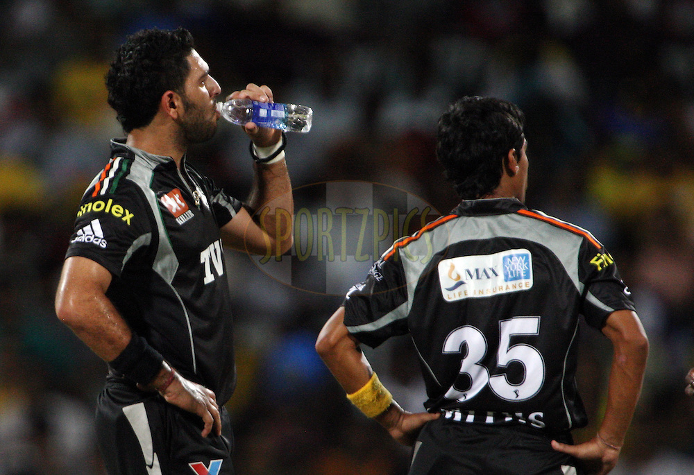 Yuvraj Singh and Mithun Manhas during match 29 of the Indian Premier League ( IPL ) Season 4 between the Chennai Superkings and The Pune Warriors held at the MA Chidambaram Stadium in Chennai, Tamil Nadu, India on the 25th April 2011..Photo by Jacques Rossouw/BCCI/SPORTZPICS .