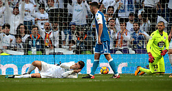 MADRID, Jan. 22, 2018  Real Madrid's Cristiano Ronaldo (Bottom) gets injured during a Spanish league match between Real Madrid and Deportivo de la Coruna in Madrid, Spain, on Jan. 21, 2018. Real Madrid won 7-1. (Credit Image: © Juan Carlos/Xinhua via ZUMA Wire)