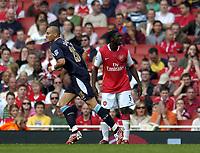 Photo: Olly Greenwood.<br />Arsenal v West Ham United. The Barclays Premiership. 07/04/2007. West Ham's Bobby Zamora celebrates scoring while Arsenal's Kolo Toure looks on