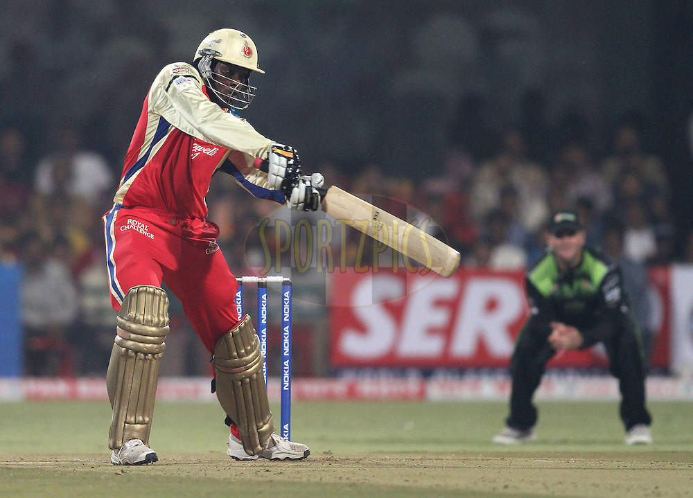 Chris Gayle of Royal Challengers Bangalore attcks a delivery during match 1 of the NOKIA Champions League T20 ( CLT20 )between the Royal Challengers Bangalore and the Warriors held at the  M.Chinnaswamy Stadium in Bangalore , Karnataka, India on the 23rd September 2011..Photo by Shaun Roy/BCCI/SPORTZPICS
