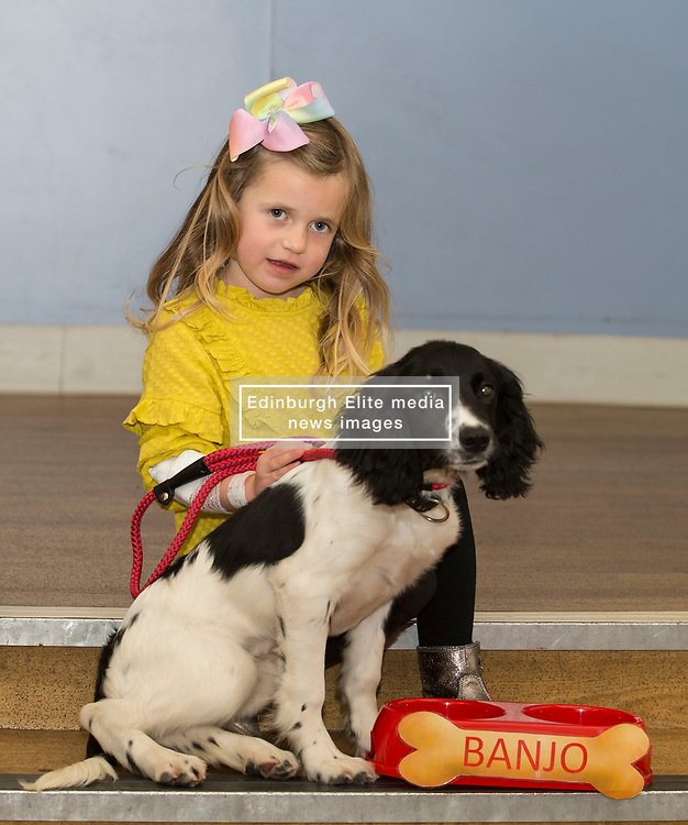 Four year old Heidi Wilkie from Prestonpans with new police dog puppy Banjo at the Royal Hospital for Sick Children in Edinburgh, where she was one of the patients who chose the names for Banjo and Sully, the two newest members of Police Scotland's dog section.<br />  <br /> © Dave Johnston/ EEm