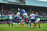Portsmouth Defender, Christian Burgess (6) with a header at goal during the EFL Sky Bet League 1 match between Portsmouth and Wycombe Wanderers at Fratton Park, Portsmouth, England on 22 September 2018.
