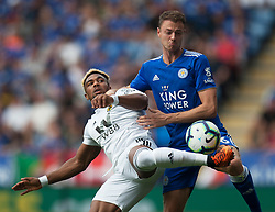 Adama Traore of Wolverhampton Wanderers (L) and Jonny Evans of Leicester City in action - Mandatory by-line: Jack Phillips/JMP - 18/08/2018 - FOOTBALL - King Power Stadium - Leicester, England - Leicester City v Wolverhampton Wanderers - English Premier League