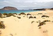 Montana Clara island nature reserve and sandy beach Playa de las Conchas, Graciosa island, Lanzarote, Canary Islands, Spain