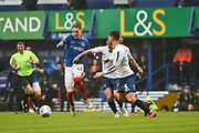Portsmouth Midfielder, Ronan Curtis (11) tackles by Wycombe Wanderers Defender, Joe Jacobson (3) during the EFL Sky Bet League 1 match between Portsmouth and Wycombe Wanderers at Fratton Park, Portsmouth, England on 22 September 2018.