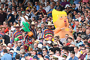 A fan in a Baby Donald Trump fancy dress costume is followed by fans in Mexican outfits in the Hollies stand during the International Test Match 2019 match between England and Australia at Edgbaston, Birmingham, United Kingdom on 3 August 2019.