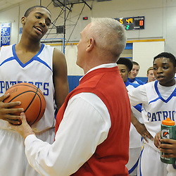 Staff photos by Tom Kelly IV<br /> Bridges is given his 1000th point ball by Athletic Director Russell Wren following the basket.  Great Valley senior Mikal Bridges (25) scored his 1000th point Friday night December 20, 2013 in a home game against Archbishop Wood.