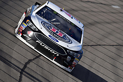 March 4, 2018 - Las Vegas, NV, U.S. - LAS VEGAS, NV - MARCH 04: Kevin Harvick (4) Stewart-Haas Racing Ford Fusion drives into turn 1 during the Monster Energy NASCAR Cup Series Pennzoil 400 on March 04, 2018 at Las Vegas Motor Speedway in Las Vegas, NV. (Photo by Chris Williams/Icon Sportswire) (Credit Image: © Chris Williams/Icon SMI via ZUMA Press)