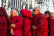 Monks wait in line to receive alms at the Ananda Pagoda Festival in Bagan, Myanmar (Burma).