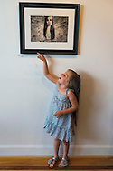 LILY CARLSON, 5, of Rock Point, is pointing to a photo of herself, 'Uncaged' by Jennifer Carlson, at the Fotofoto Gallery Opening Reception of the 2013 'Under The Influence' Student Invitational Exhibition. On display were images of 29 photography students of instructors from fotofoto, the event venue.