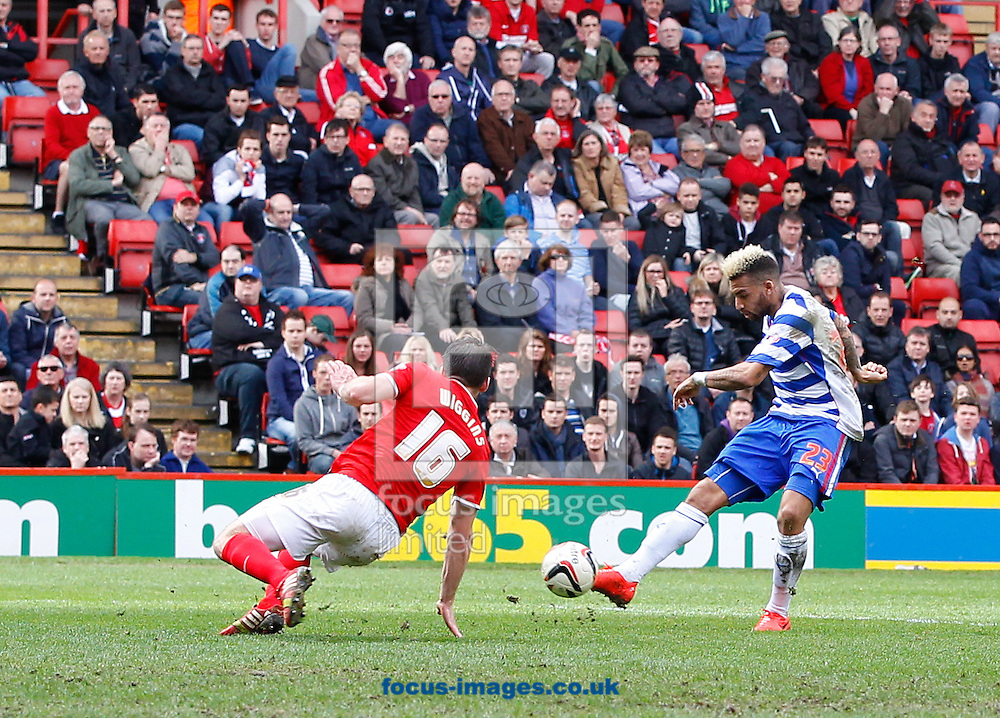 Daniel Williams of Reading (R) scores their first goal past Rhoys Wiggins of Charlton Athletic during the Sky Bet Championship match at The Valley, London<br /> Picture by Andrew Tobin/Focus Images Ltd +44 7710 761829<br /> 05/04/2014