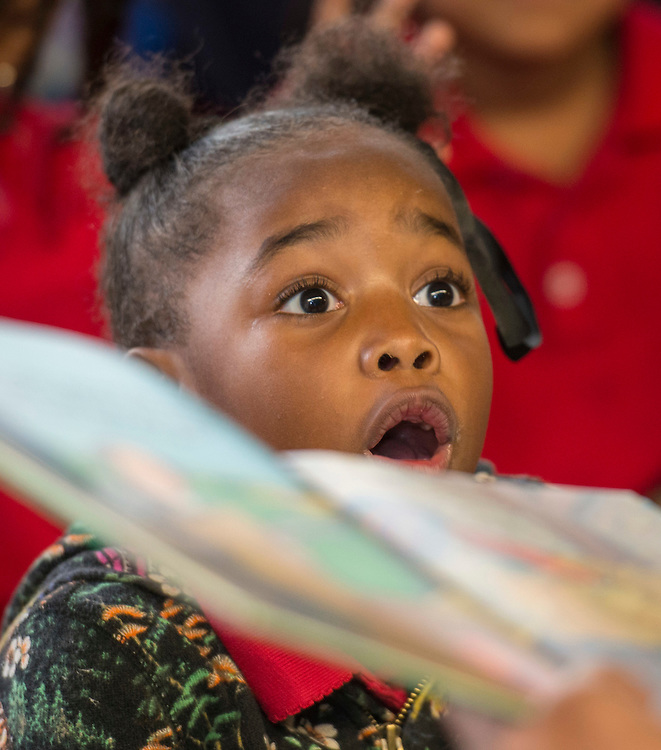 Students react to a story during a Touchdown Houston literacy program at NQ Henderson Elementary School, November 11, 2016.