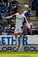 Photo: Steve Bond/Richard Lane Photography. Leicester City v Carlisle United. Coca Cola League One. 04/04/2009. Danny Graham (L) and Patrick Kisnorbo (R) in the air