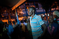 A voter waits in line before dawn for the polls to open. Olympic Primary School Polling Station, Kibera, Nairobi, Kenya. Many Kenyans said they felt proud, and excited, to be voting, and that they felt confident in the process this time around, unlike 2007.