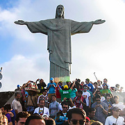 International crowds swarm Christ the Redeemer as the World Cup in Brazil draws to a close in July, 2014.
