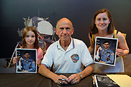 Garden City, New York, U.S. July 20, 2019. At center, NASA Space Shuttle astronaut BOB CENKER poses with, at left, LUCY DEEGAN, 8, and MEREDITH DEEGAN, both of Swords, a town near Dublin, Ireland, at the Moon Fest Apollo at 50 Countdown Celebration at Cradle of Aviation Museum in Long Island, held at the same time the Apollo 11 Lunar Module, The Eagle, landed on the Moon 50 years ago. Deegan grew up in Greenlawn, NY.