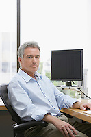 Business man sitting in office portrait