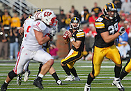 October 23 2010: Iowa Hawkeyes quarterback Ricky Stanzi (12) looks for a receiver during the first half of the NCAA football game between the Wisconsin Badgers and the Iowa Hawkeyes at Kinnick Stadium in Iowa City, Iowa on Saturday October 23, 2010. Wisconsin defeated Iowa 31-30.