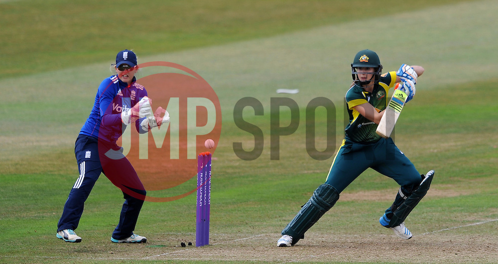 Australia's Ellyse Perry cuts the ball as England's Sarah Taylor looks on. - Photo mandatory by-line: Harry Trump/JMP - Mobile: 07966 386802 - 21/07/15 - SPORT - CRICKET - Women's Ashes - Royal London ODI - England Women v Australia Women - The County Ground, Taunton, England.