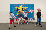 (Gabe Green | The Daily World)<br /> <br /> From left; Andres Barragan Caz Rofling, Todd Mefford and Kris Brown play on and around the buddy bench at Central Elementary School Wednesday morning.