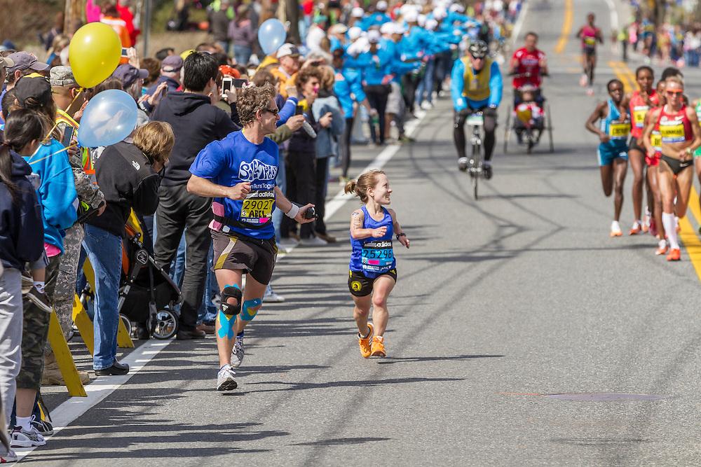 2014 Boston Marathon: small statured runner Juli Windsor watches as elite women race by