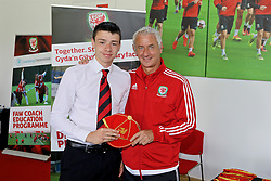 NEWPORT, WALES - Sunday, May 28, 2017: Jake Jones receives a cap from Elite Performance Director Ian Rush for participation during day three of the Football Association of Wales' National Coaches Conference 2017 at Dragon Park. (Pic by Mark Roberts/Propaganda)
