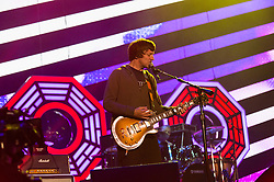 © Licensed to London News Pictures. 13/06/2015. Isle of Wight, UK.   Blur performing live at Isle of Wight Festival 2015, Day 3 Saturday,headlining the main stage.  In this picture - Graham Coxon.   Headline acts include The Prodigy, Blur and Fleetwood Mac.   Photo credit : Richard Isaac/LNP