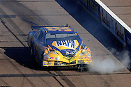 Nov. 15, 2009; Avondale, AZ, USA; NASCAR Sprint Cup Series driver Michael Waltrip after crashing during the Checker O'Reilly Auto Parts 500 at Phoenix International Raceway. Mandatory Credit: Jennifer Stewart-US PRESSWIRE