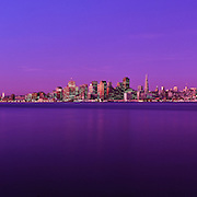 San Francisco California skyline and Oakland Bay Bridge at sunrise from Treasure Island