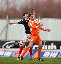 Falkirk's Johnny Flynn  and Forfar Athletic's Chris Templeman..Falkirk 4 v 1 Forfar Athletic, Scottish Cup fifth round tie, 2/2/2013. .©Michael Schofield.