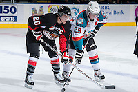 KELOWNA, CANADA -FEBRUARY 25: Troy Bourke #20 of the Prince George Cougars faces off against Myles Bell #29 of the Kelowna Rockets on February 25, 2014 at Prospera Place in Kelowna, British Columbia, Canada.   (Photo by Marissa Baecker/Getty Images)  *** Local Caption *** Troy Bourke; Myles Bell;