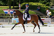 Florentina Gisi Lorenz - Sir Anthony 3<br /> FEI European Dressage Championships for Young Riders and Juniors 2013<br /> © DigiShots