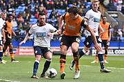 Bolton Wanderers Midfielder, Mark Davies and Hull City Defender, Harry Maguire on the ball during the Sky Bet Championship match between Bolton Wanderers and Hull City at the Macron Stadium, Bolton, England on 30 April 2016. Photo by Mark Pollitt.